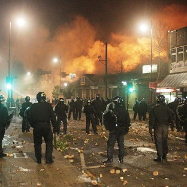 Police take to the streets during last summer's London riots