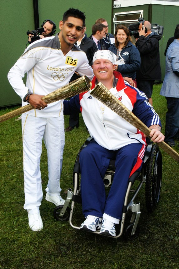 Adrian Derbyshire with Amir Khan when he carried the Olympic Torch last year.