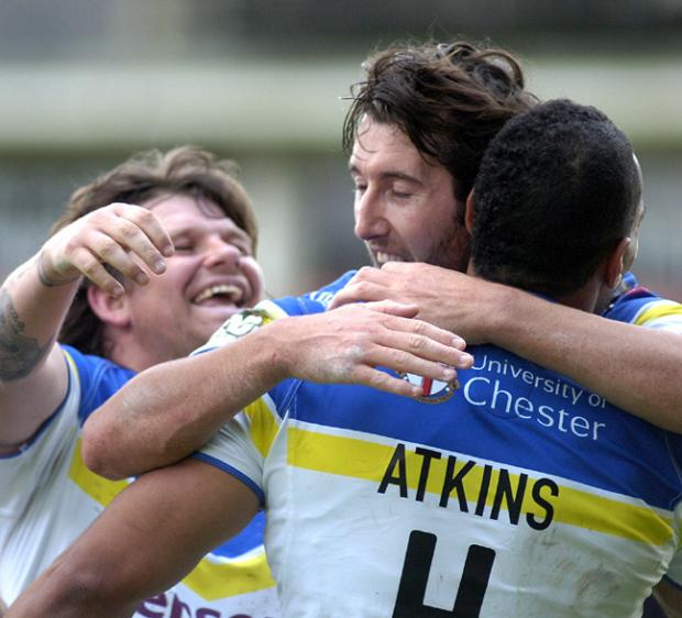 Lee Briers and Stefan Ratchford congratulate Ryan Atkins after one of his three tries against Hull FC. Pictures by Mike Boden