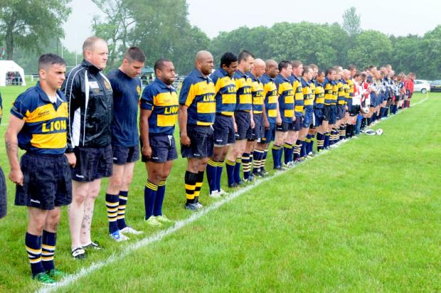 Teams line up before the match