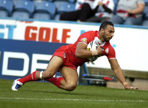 Wolves' Ryan Atkins finishes off his 90-metre try against Exiles. Pictures by Mike Boden