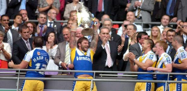 Paul Wood gets his hands on the cup in 2010 after missing the 2009 final with injury
