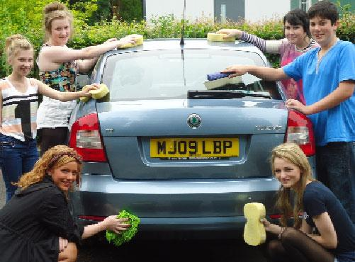 Pupils get stuck in to the car wash