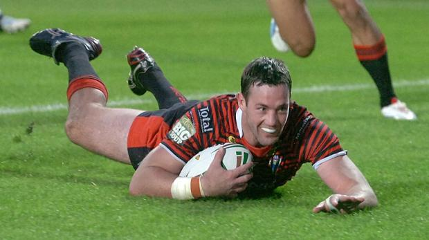 Trent Waterhouse slides over for his try early in the second half. Pictures by MIKE BODEN
