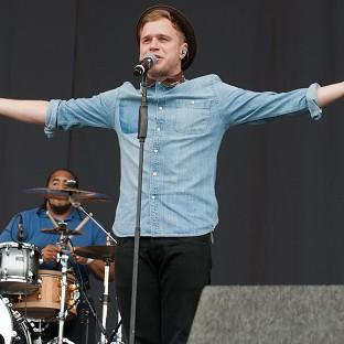 Olly Murs peforms to festival goers on main stage of V Festival in Weston Park