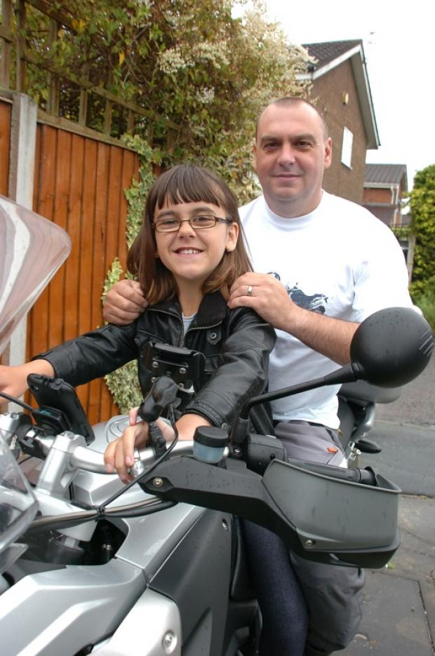 Lee with daughter Robin on his bike