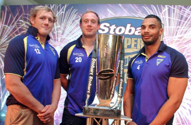 Wolves' Dream Team trio pose with the Super League trophy at Old Trafford