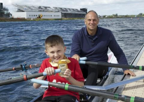 Lloyd enjoys his rowing session with Sir Steve Redgrave at Eton Dorney