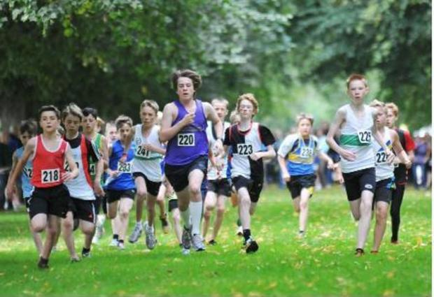 Luke Gamble, red vest, at the start of Warrington under 13s boys' silver relay success at Marbury Park