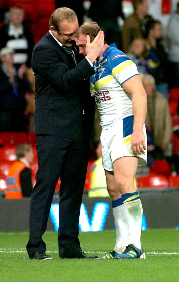 Garreth Carvell comforts Micky Higham after the final hooter