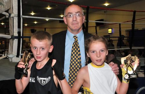 Billy Dunne (Phoenix Fire) and  Kian Flanagan (Leigh ABC) being presented with trophies from 1980 Moscow Olympian, 3x ABA Champion and British Pro- Featherweight champion Ray Gilbody