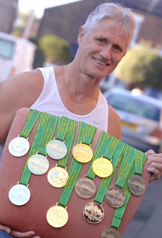 David Gill and his 13 medals