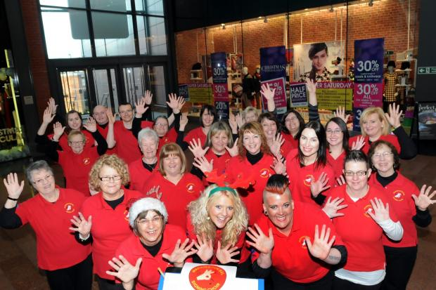 Signing choir impress shoppers