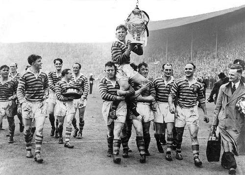 Warrington skipper Harry Bath is chairlifted by his teammates with the Challenge Cup at Wembley in 1950