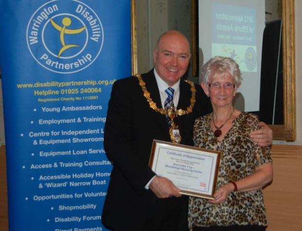 Nanette Foy picks up her award from Mayor of Warrington Clr Steve Wright