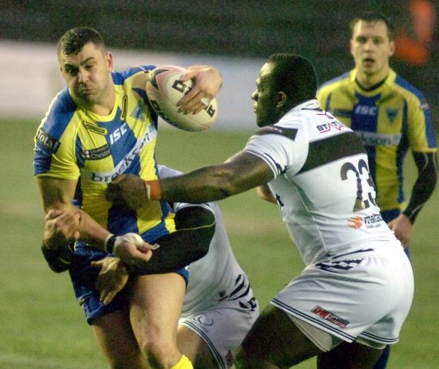 Warrington Guardian: Rhys Williams is stopped by Phil Joseph. Pictures by MIKE BODEN