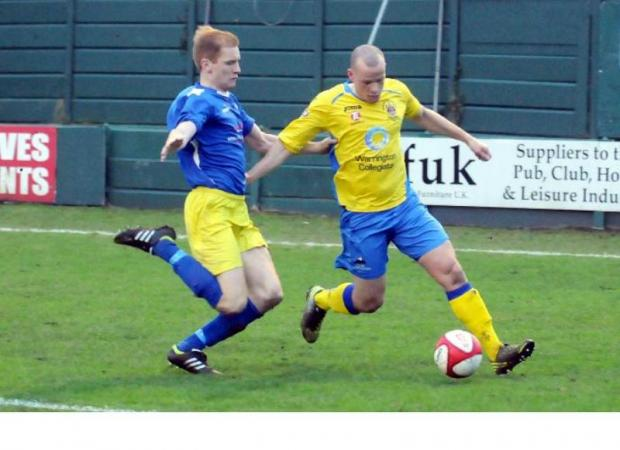 Town, in yellow, were second best against Cammell Laird on New Year's Day.	Picture: DAVE GILLESPIE DGG010113