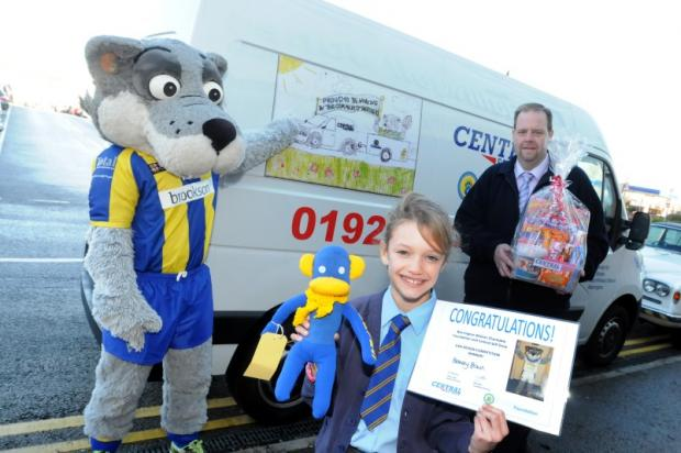 Winner Bethany Brown and John Green, branch manager at Central Van Hire with Wolfie