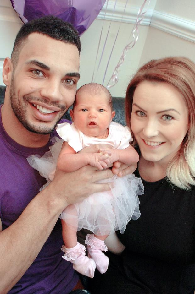 Ryan Atkins with partner Stevie and baby Nala