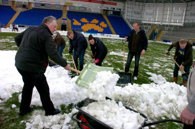 Fans help clear the pitch