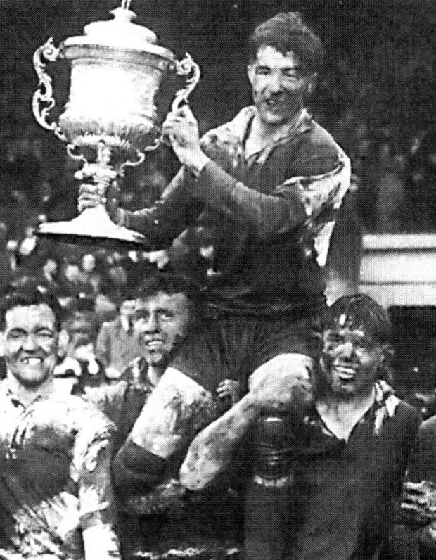 Warrington Guardian: Albert Naughton lifts the Championship trophy for Warrington in 1955