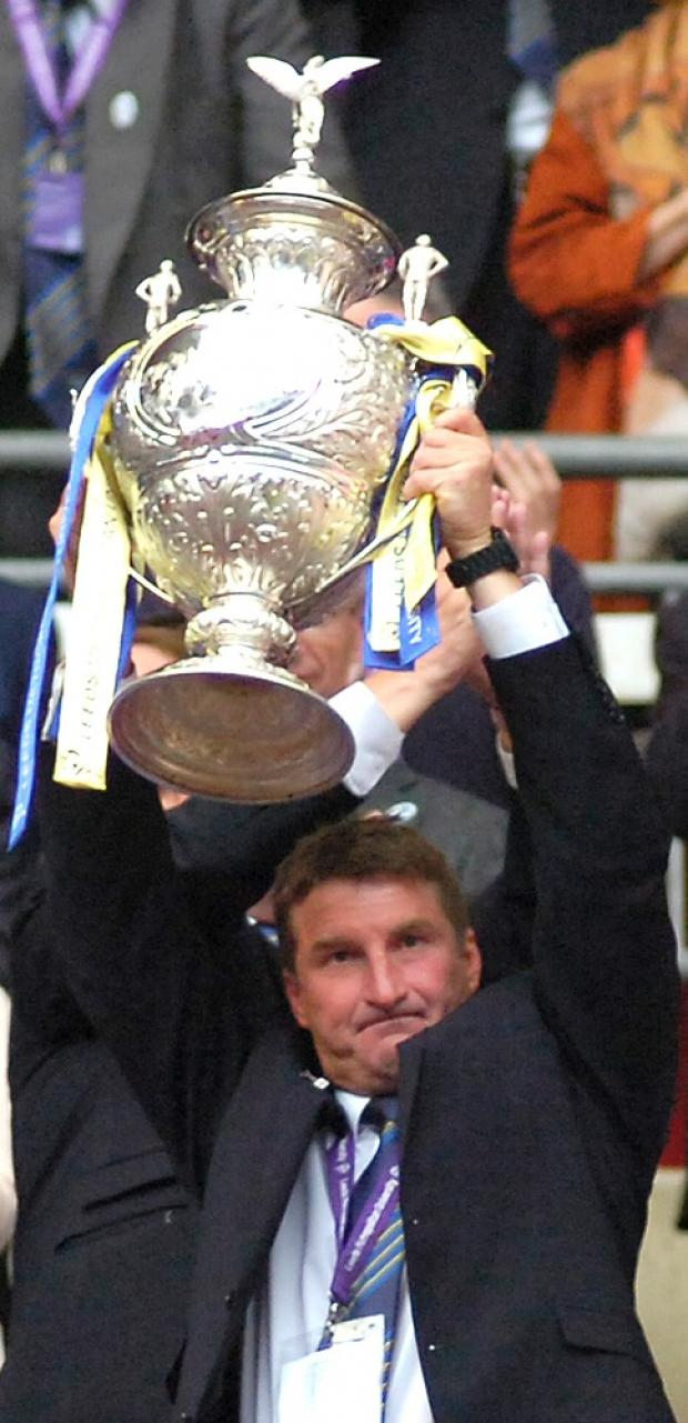 Tony Smith lifting the Challenge Cup for Warrington Wolves at Wembley last August