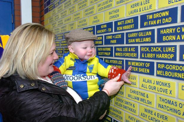 Looking for the brick in memory of granddad is Bobby Pownall, aged one, with Samantha Sheen