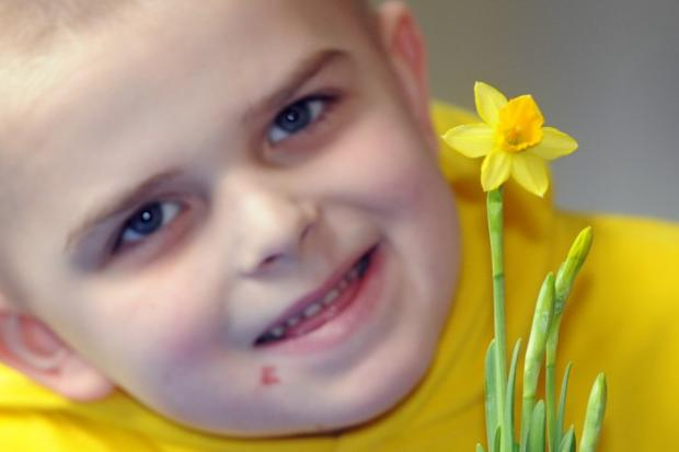 Aaron Ramsbottom with his daffodil in bloom