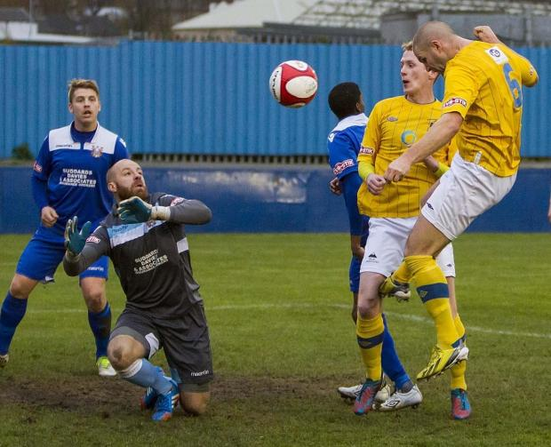 Craig Robinson heads in Town's second goal at Farsley. Picture: JOHN HOPKINS