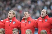 Ben Westwood and Chris Hill belt out the national anthem alongside Brett Ferres