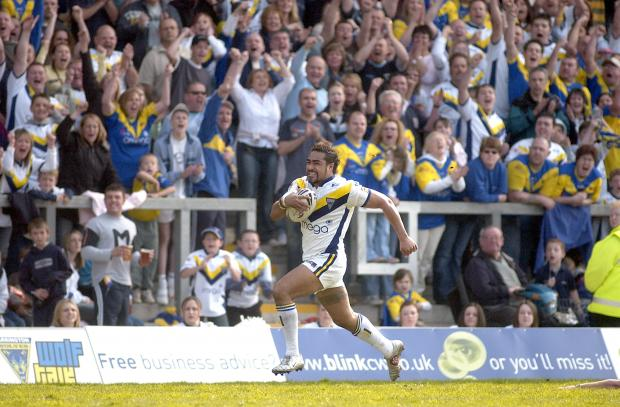 Warrington Guardian: Henry Fa'afili flying to the try line in front of the South Stand