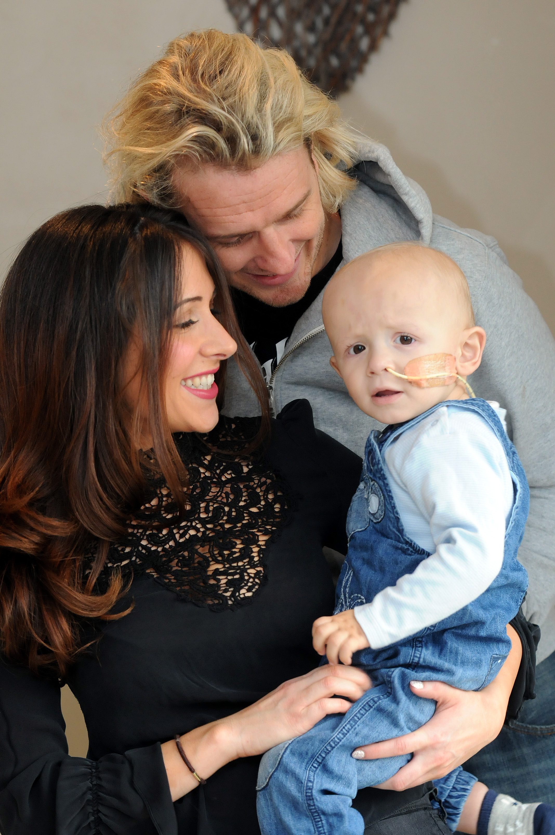 Parents Alexandria Mckenzie and Stephen Royle with brave tot Parker
