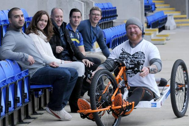 From left to right: Adrian Derbyshire with Leon Moye, Rachel Wright and Stuart Farley from Gladstone Brookes with Danny Obrien and Neil Kelly from the Warrington Wolves Foundation