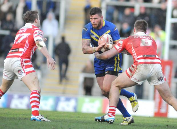 Warrington Guardian: Glenn Riley carries the ball into Leigh defenders for Wolves on Sunday. Picture by Mike Boden