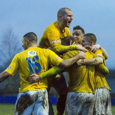 Yellows players celebrate a goal in the latest win at Padiham. Picture by John Hopkins