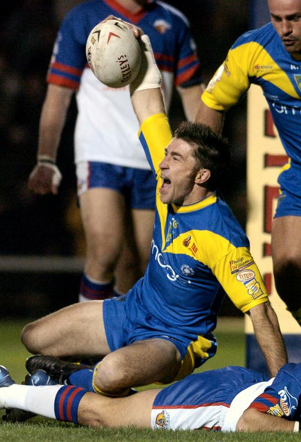 Warrington Guardian: Nathan Wood celebrates scoring the first ever try at The Halliwell Jones Stadium against Wakefield Trinity Wildcats in February, 2004
