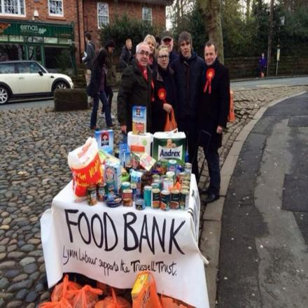 Ian Brown snapped with food bank collectors