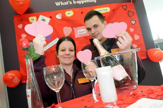 Marcia Smith and trainee manager Kris Dey are helping customers get in the mood for love
