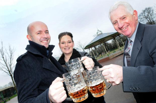Festival organisers Andy and Jade Mulholland raise a toast with Halton Clr Eddie Jones