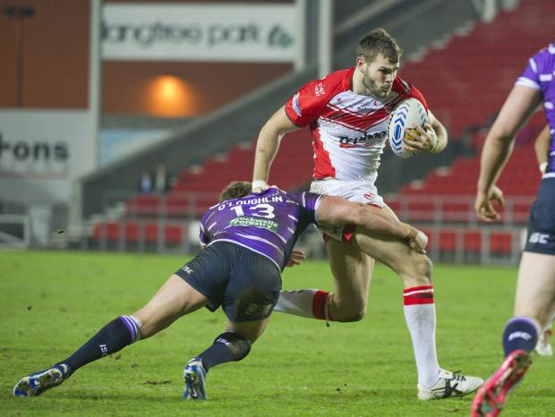 Alex Walmsley on the charge for Saints in their recent friendly against Wigan. Picture by Bernard Platt