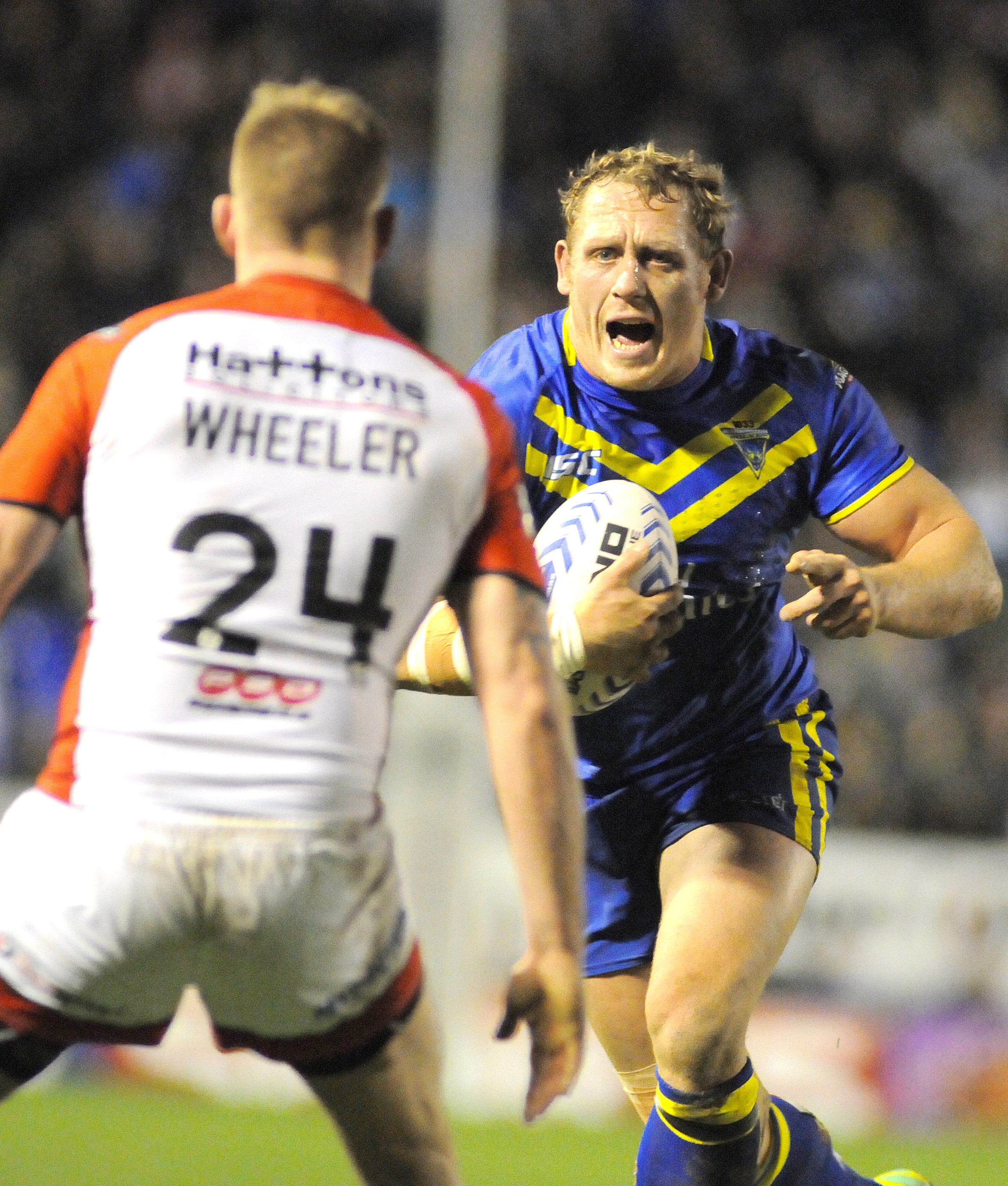 Ben Westwood charges towards Gary Wheeler during Wolves' opening week defeat against St Helens