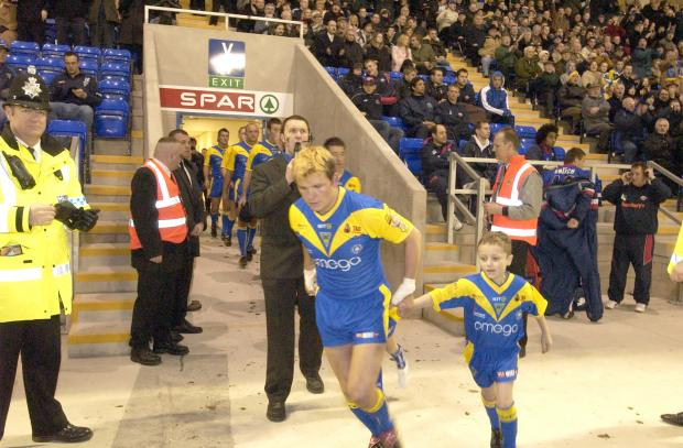 Warrington Guardian: Skipper Lee Briers runs out for the opening match