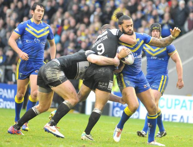 Gene Ormsby is hooked by Hull FC hooker Danny Houghton in Sunday's Super League encounter at The Halliwell Jones Stadium