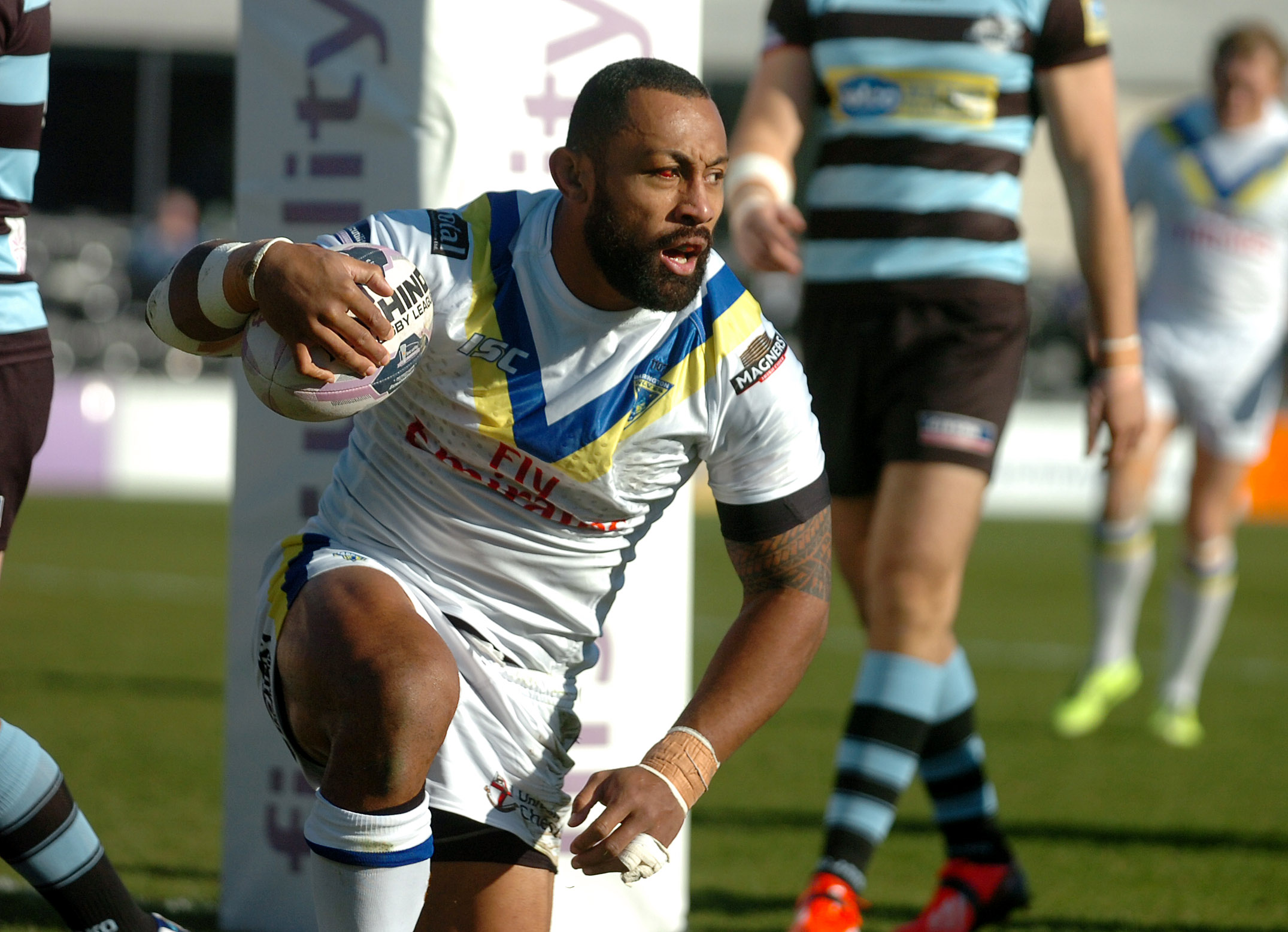 Roy Asotasi regaining his feet after scoring his first try for Warrington Wolves, the third minute opener in the 44-16 win at London Broncos. Picture by Mike Boden