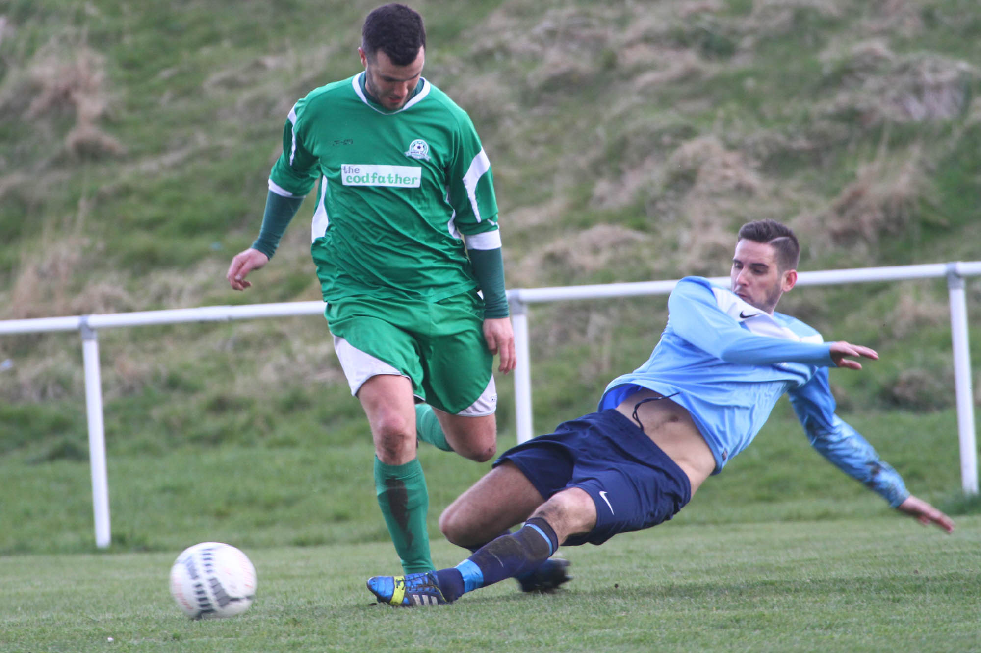 An Eagle player gets his foot in against Rudheath