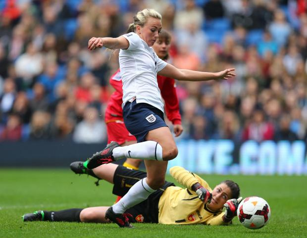 Warrington Guardian: Englands's Toni Duggan goes around Montenegro's Marija Zizic to score her second goal
