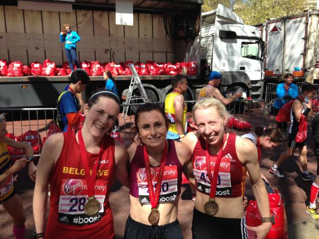 Louise Blizzard, right, with her Belgrave Harriers team at the end of her 20th London Marathon