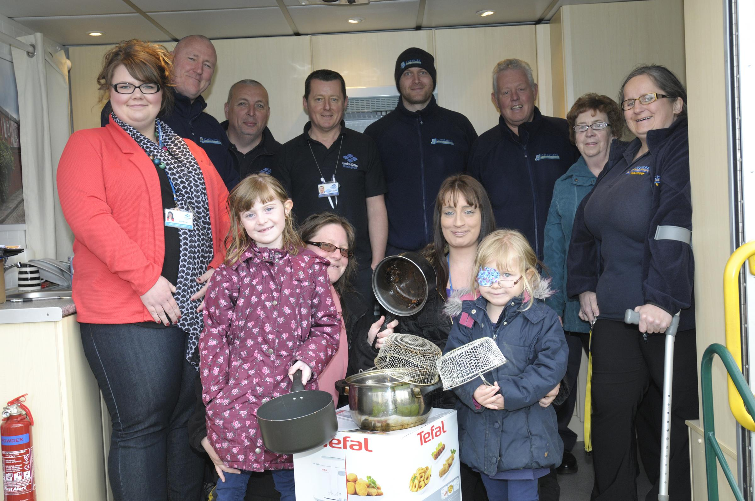 Staff from Golden Gates Housing Trust, Cheshire Fire and Rescue Service and the Warrington public health team help residents swap to healthier and safer frying methods