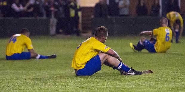 Town deflated after play-off loss ends promotion dream. By John Hopkins.