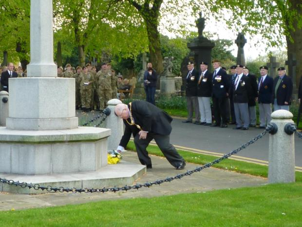 The Mayor of Warrington Clr Peter Carey lays a wreath at the service